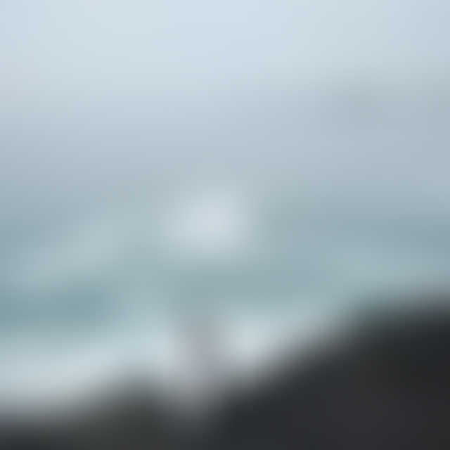 Picture of a couple on the black rocks in Ucluelet