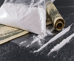 This is a picture of a cocaine bag, cocaine line and money