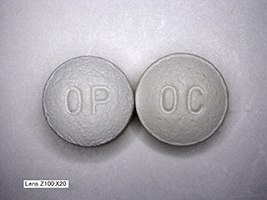 This is a picture of two white 10 mg Oxycontin pills