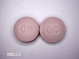 This is a picture of two pink 20 mg Oxycontin pills