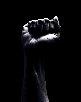 This is a black and white picture of a black person's fist