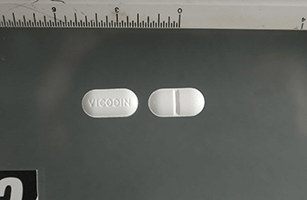 This is a picture of a Vicodin 5mg pill