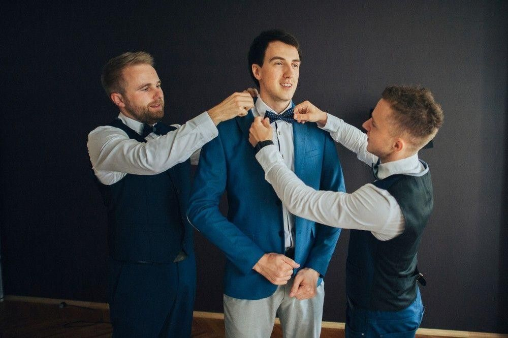 bestman fixing the suits