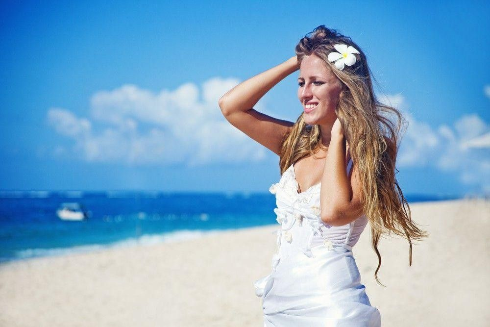 Bride in a white dress on the beach