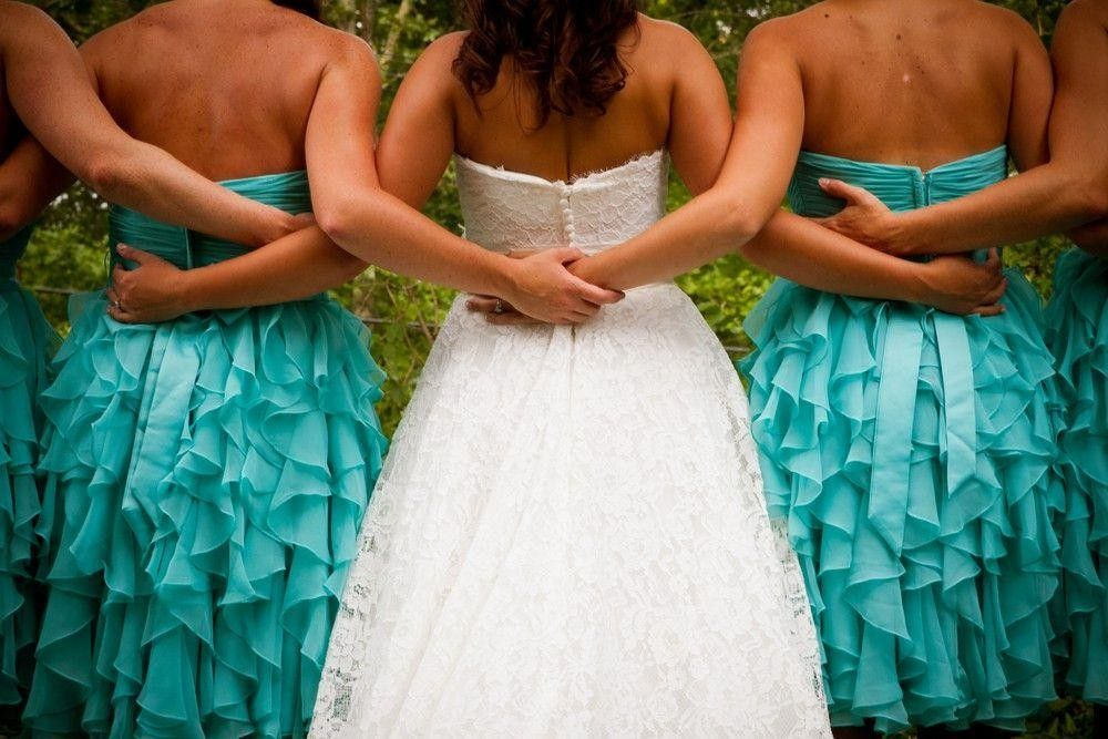 Bridesmaids and a bride holding hand