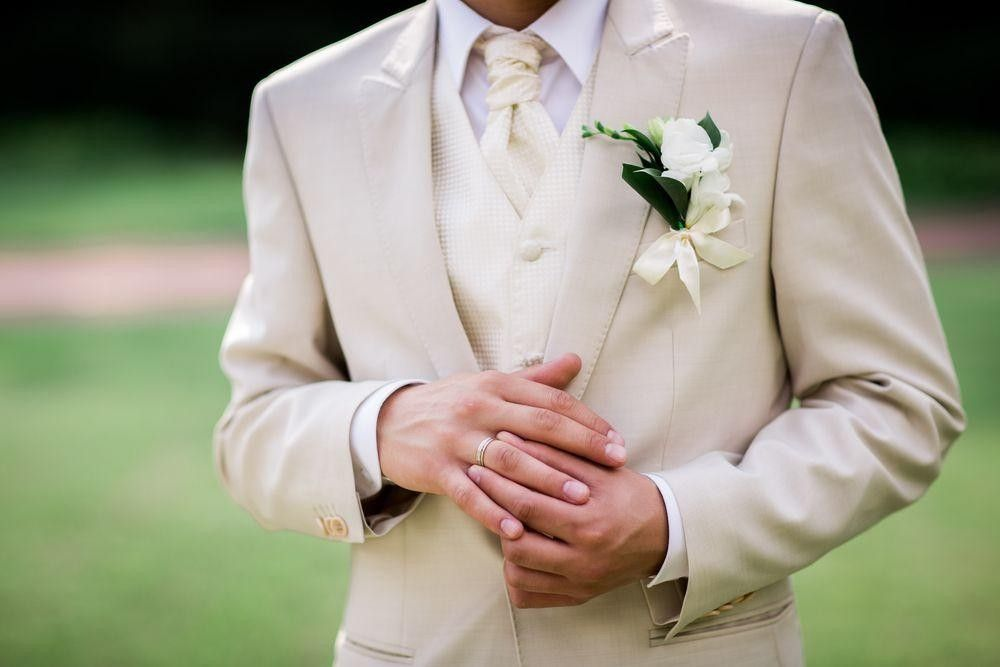 Groom in a white suit
