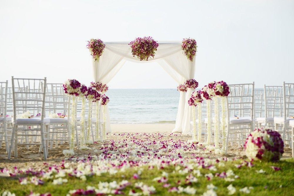 Beach decor with path of flowers