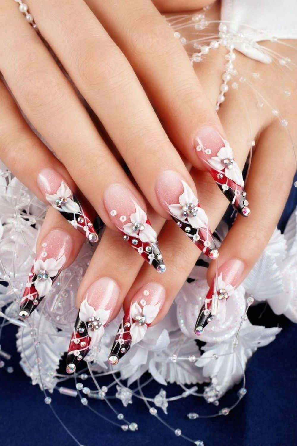 Beautifull nails with diamonds and flowers