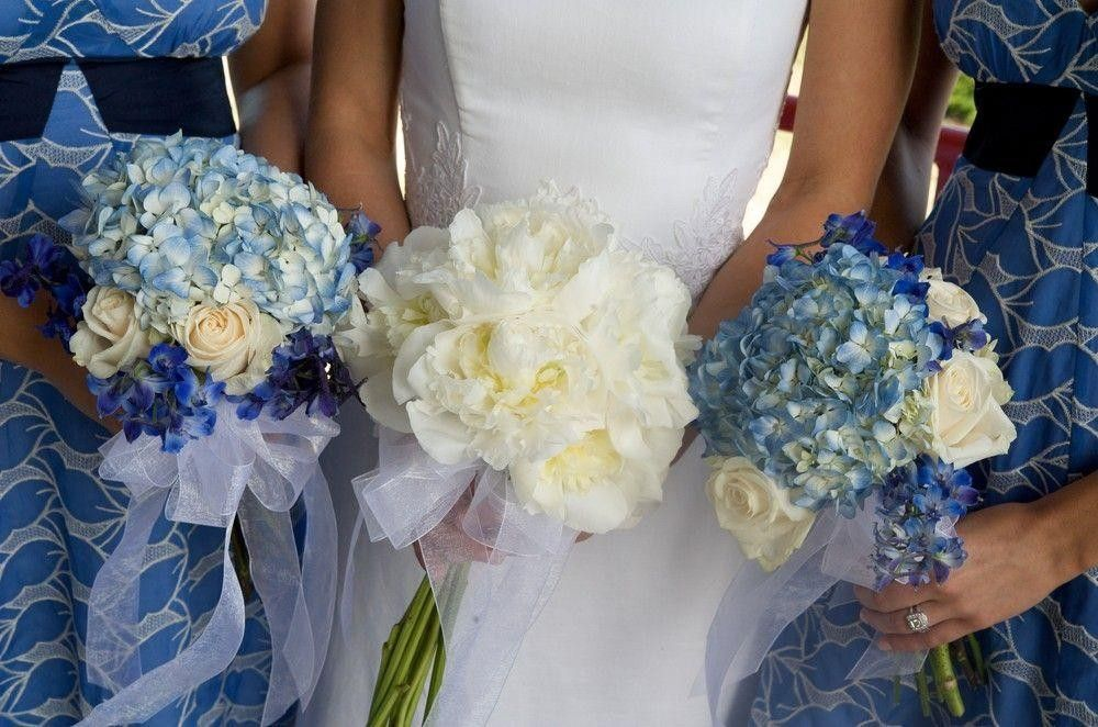 Bride and Bridesmaid wearing blue dresses