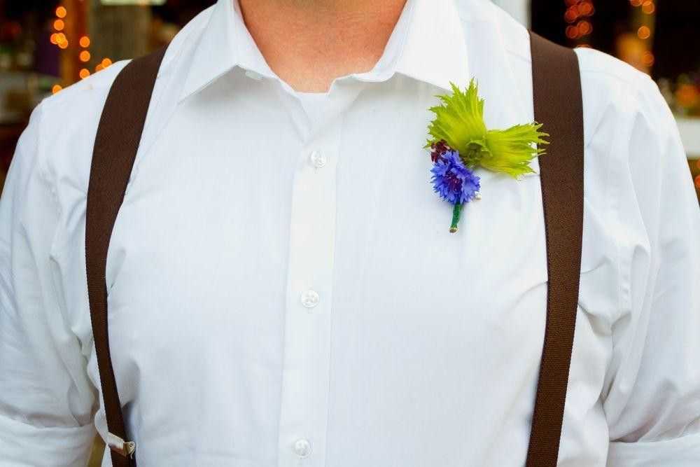 Groom witha blue buttonhole with flowers