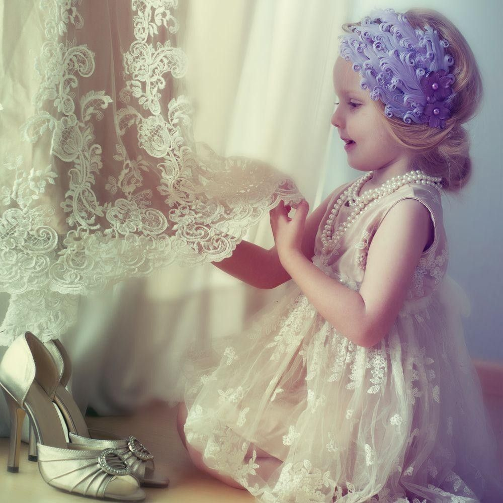 Girl Flower looking at a wedding dress