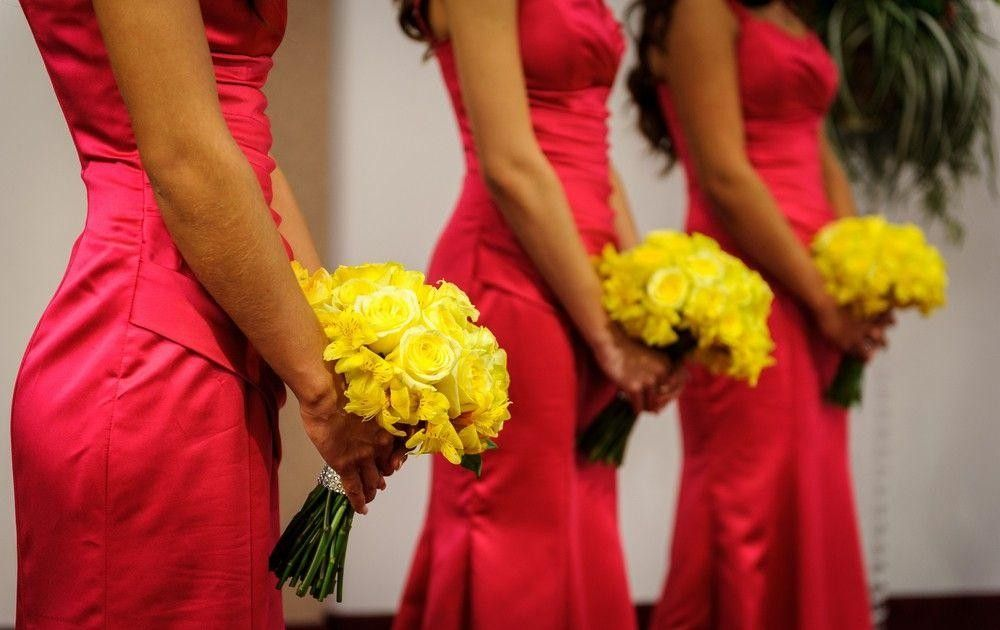 three Bridesmaids in red dresses