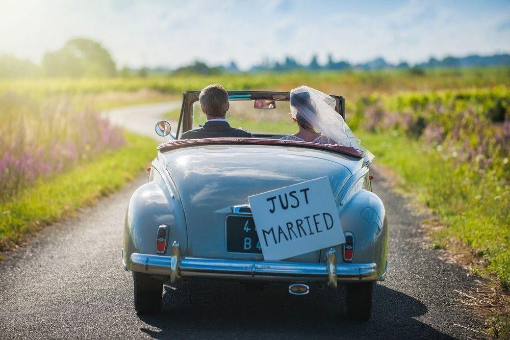 Married couple in a vintage car