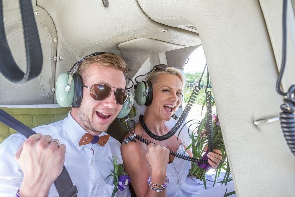 Bride and groom in an helicopter