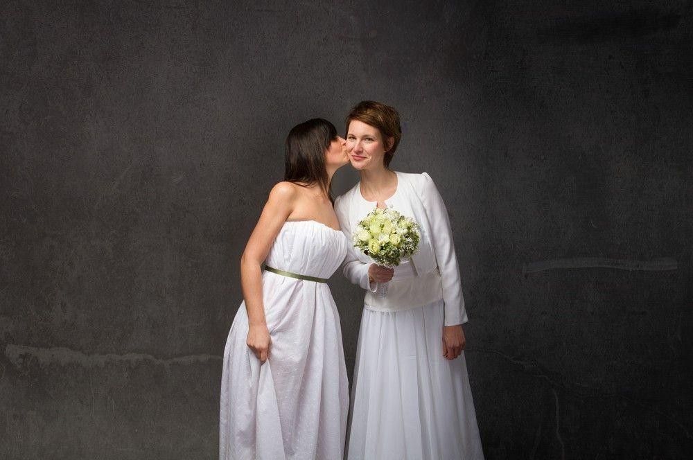 Bride in a white dress with her bridesmaid