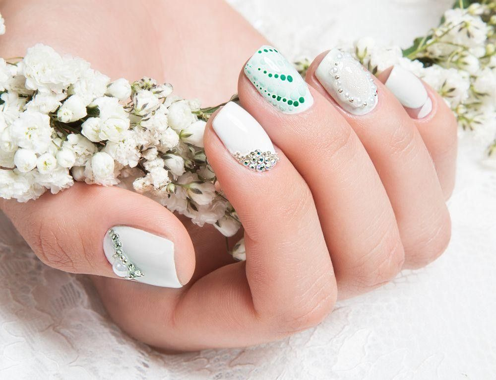 Nails with diamond and green dots