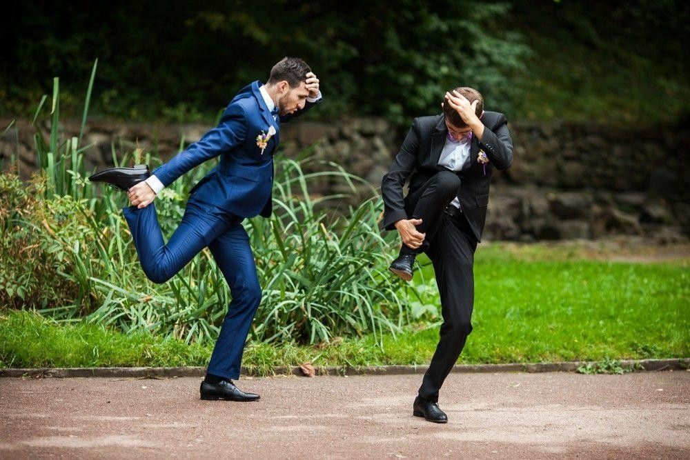 Bridegroom having fun with his best man