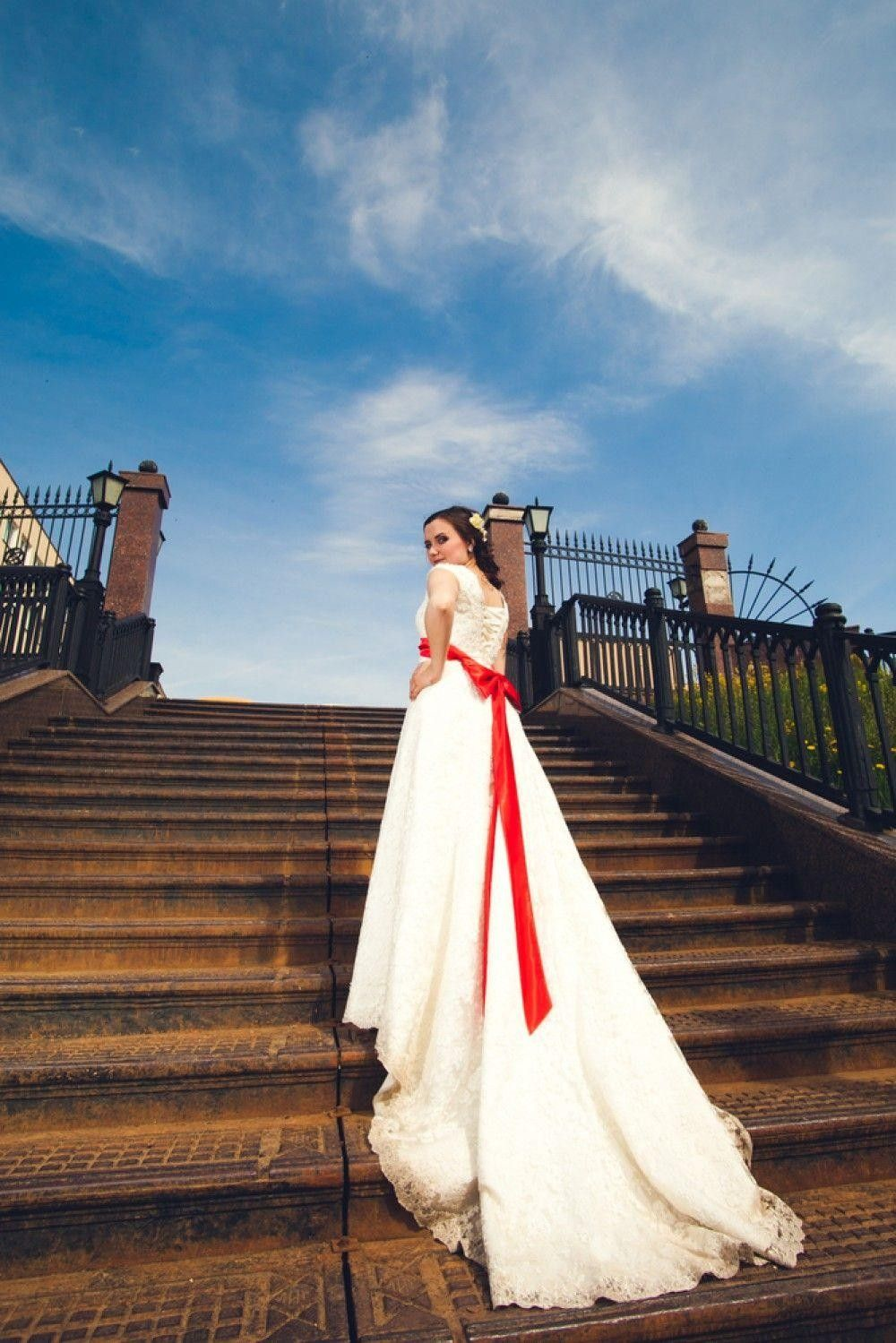 Bride with a very long tail wedding dress