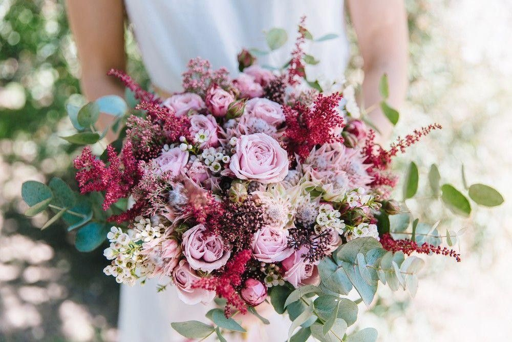 Bride a multicolor bouquet