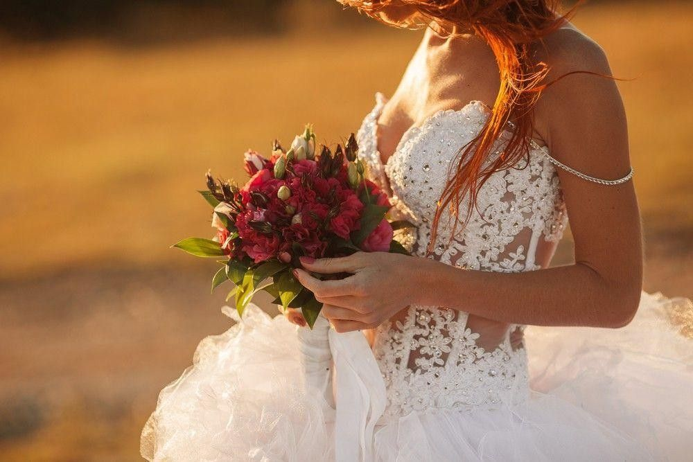 White dress with the bride holding a bouquet
