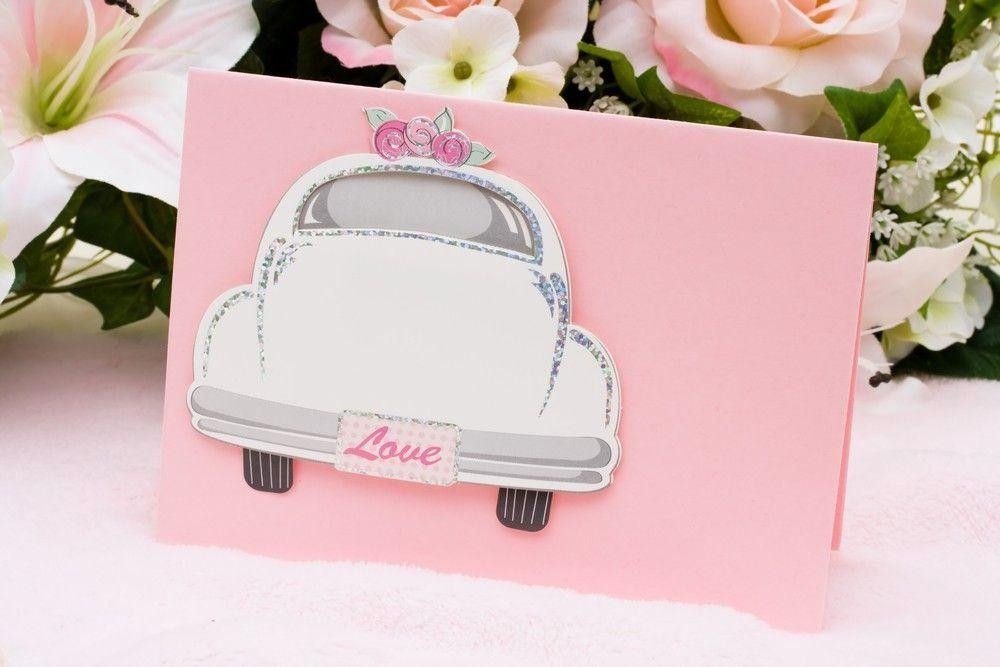 Pink invitation card with an automobile on it