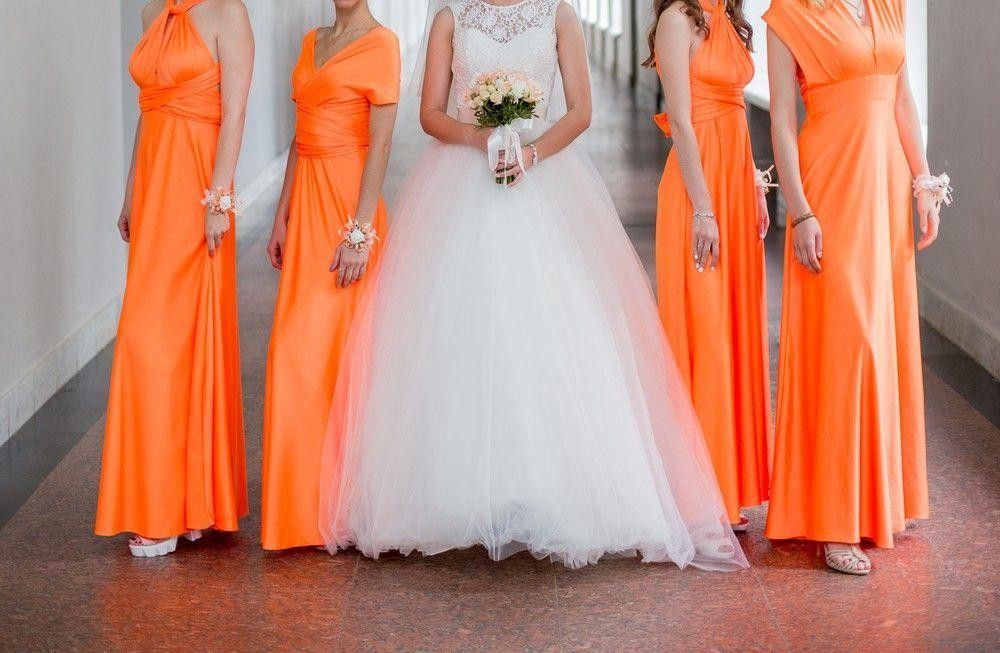 Bridesmaid dressed in orange