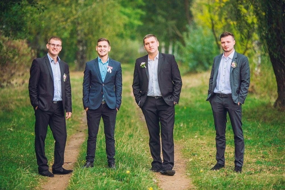 Bridegroom with his best men in a country environment