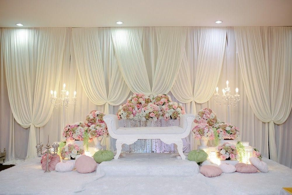 Love seat in a beautiful flower and decor arrangement