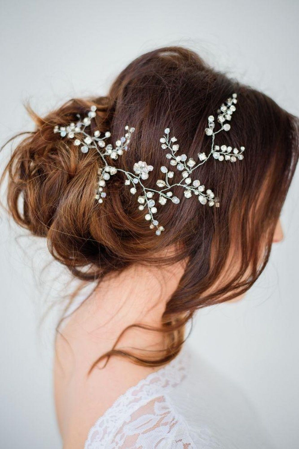 Hairstyle with delicate flowers at the back