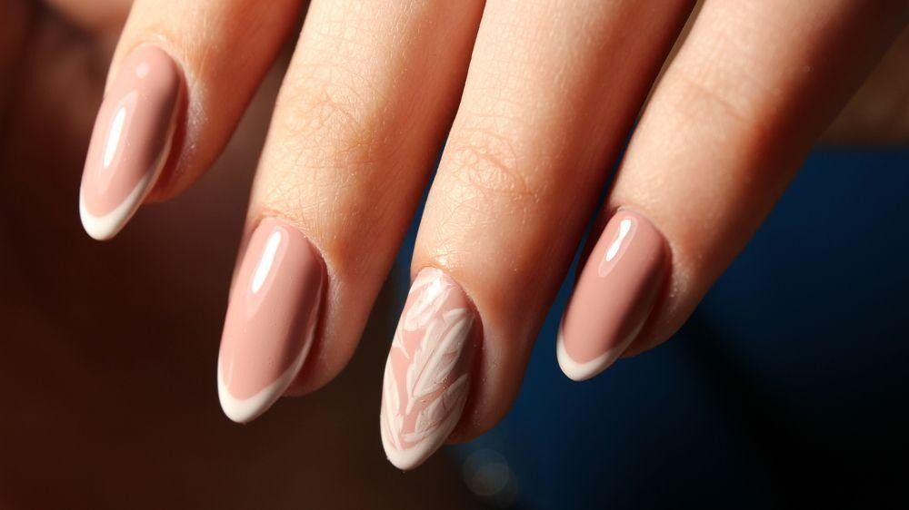 Pink nails with a flower on one nail