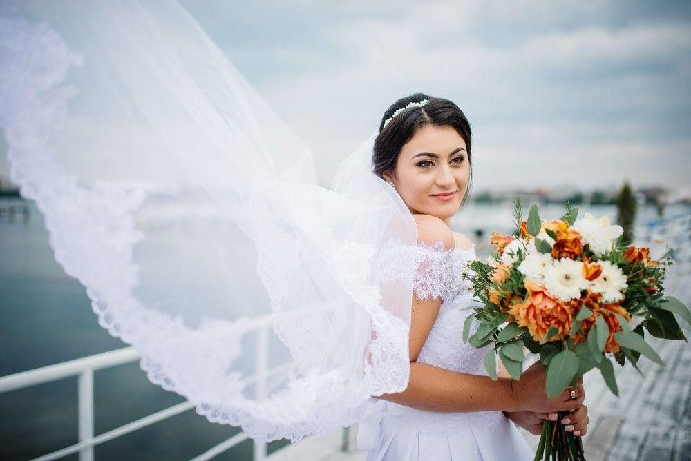 Bride on a boat with a white dress