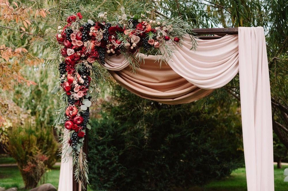 Arch with curtains decorated with red flowers