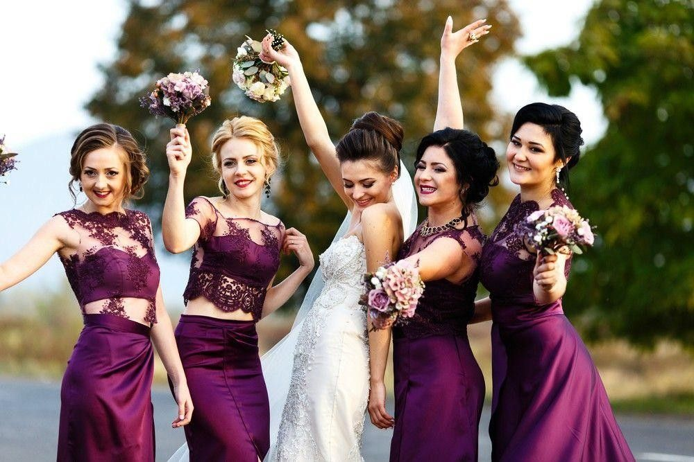Bride with bridesmaids dressed in fuchsia