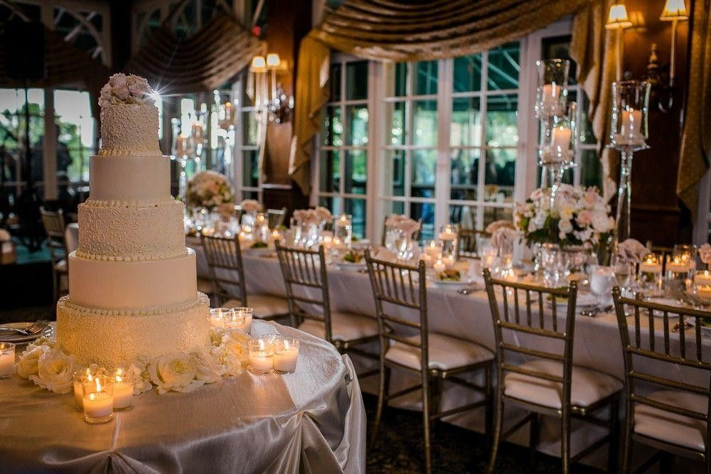 Seatings with a wedding cake on a table