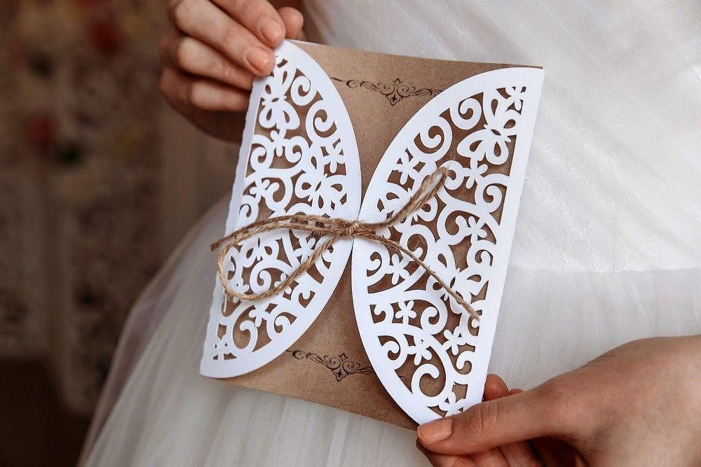 Bride holding a nice invitation card in her hand