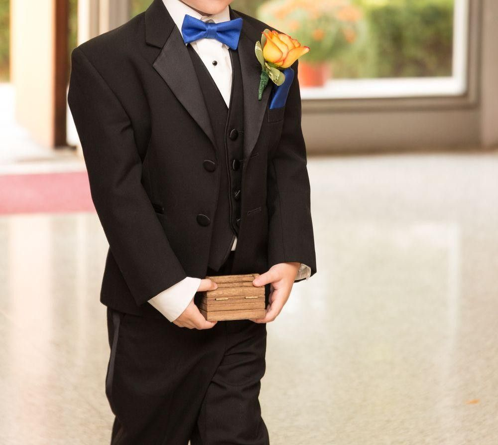 Ring bearer holding a small box