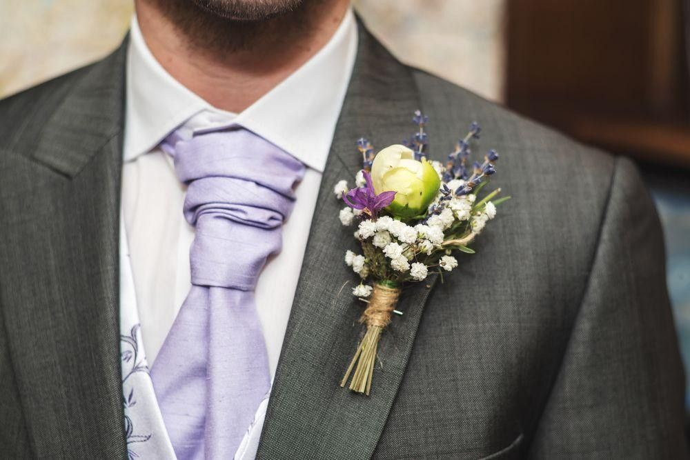 Groom Suit with a flower buttonhole