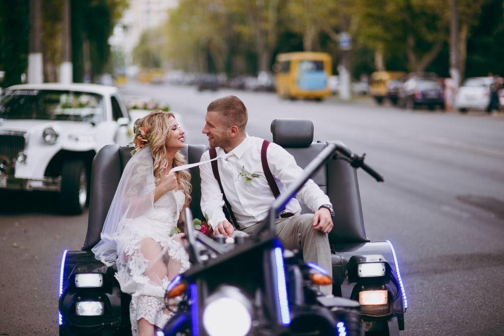 Bride and groom in a modern car