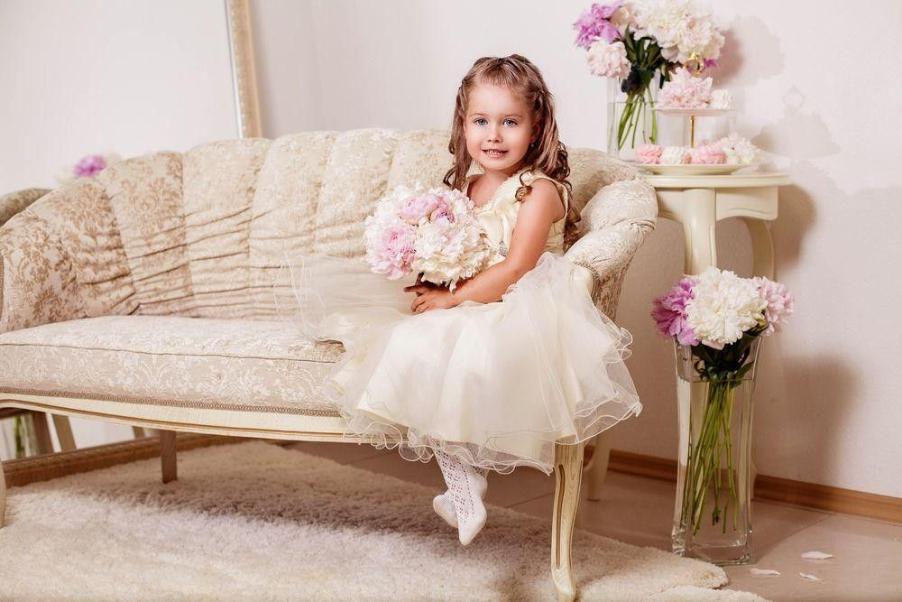 Little girl sitting with a bouquet