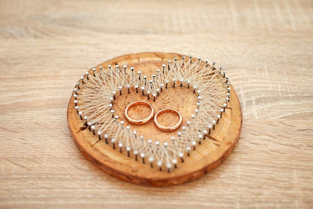 2 Rings in a heart made with pins