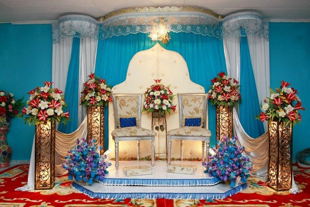 Flower Arrangement on a stage with 2 chairs