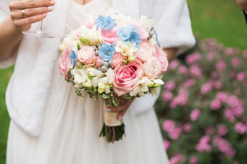 Multicolor bouquet in Bride's hand