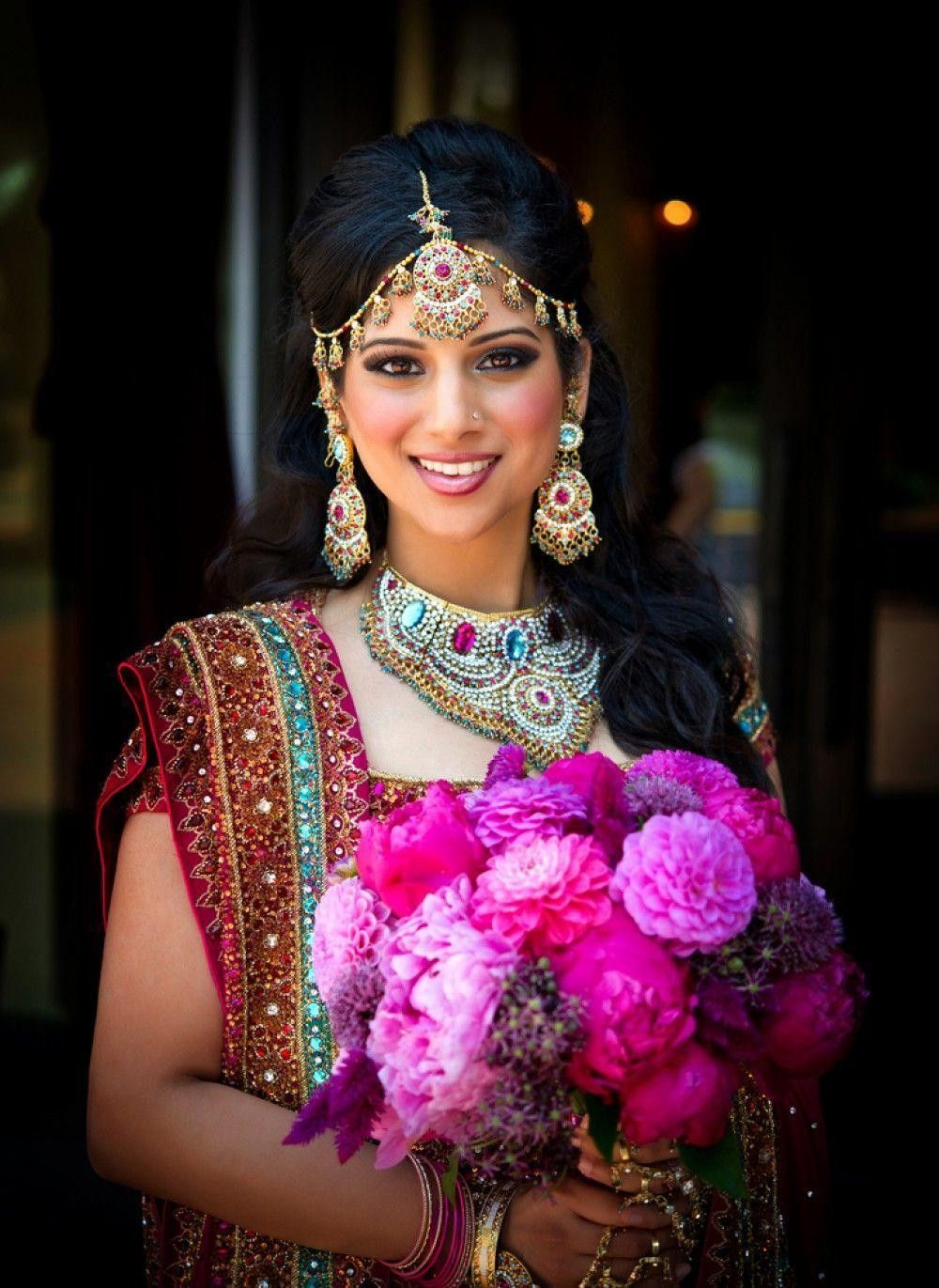 Indian bride with a pink bouquet