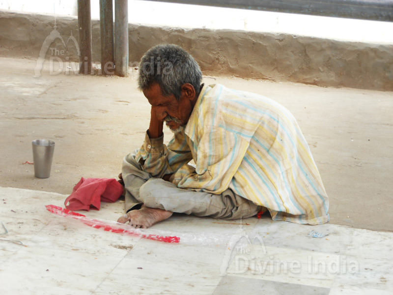 Old Man is Begging outside the Jain Temple.