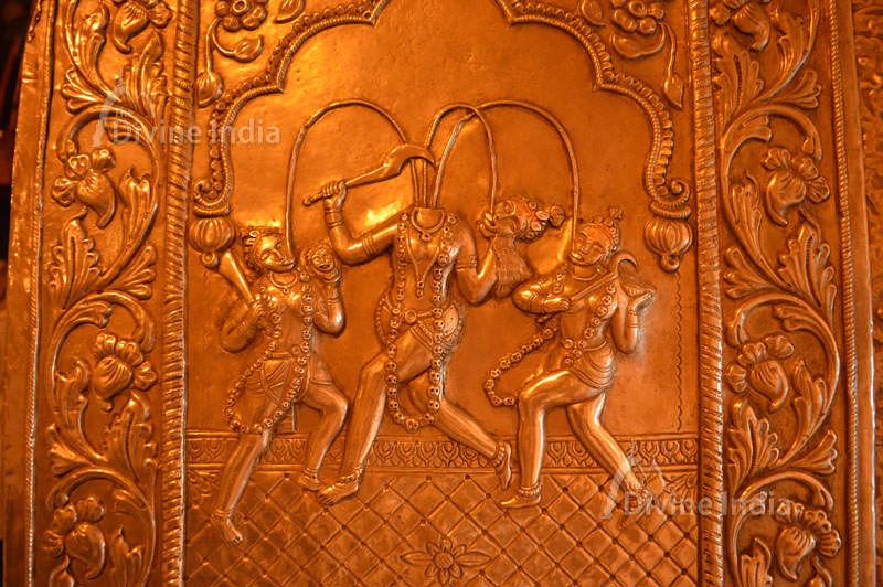 Devi Chandi Devi Jaya and Devi Vijaya emboss picture at Chinpturni temple entrance gate