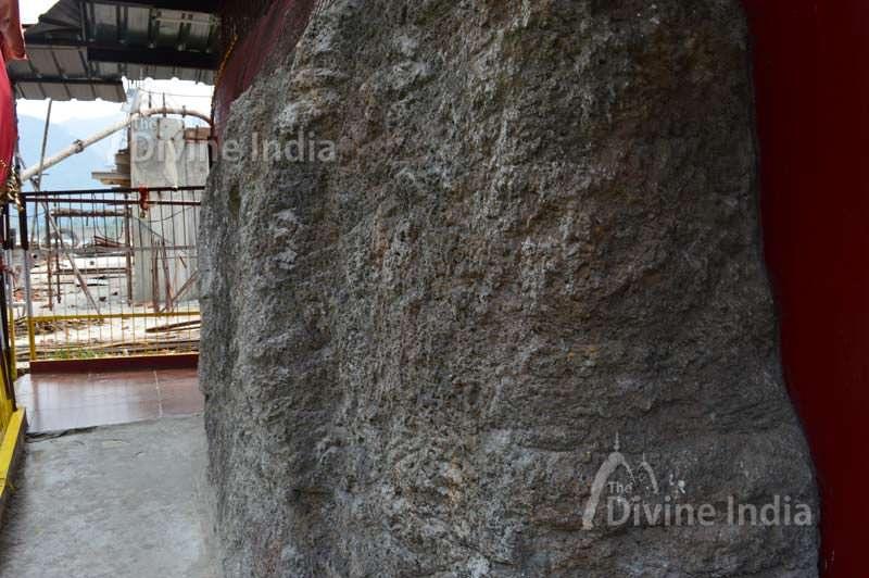 inside rock and backside of dhari devi idol