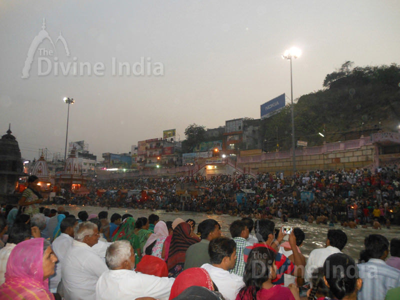 People sitting on the steps of the ghat waiting for the Ganga Arati