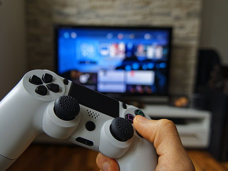 hand with a gaming controller