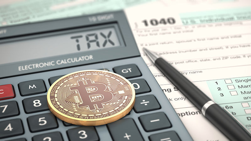 close-up view of a bitcoin coin, an electronic calculator and a tax form (3d render)