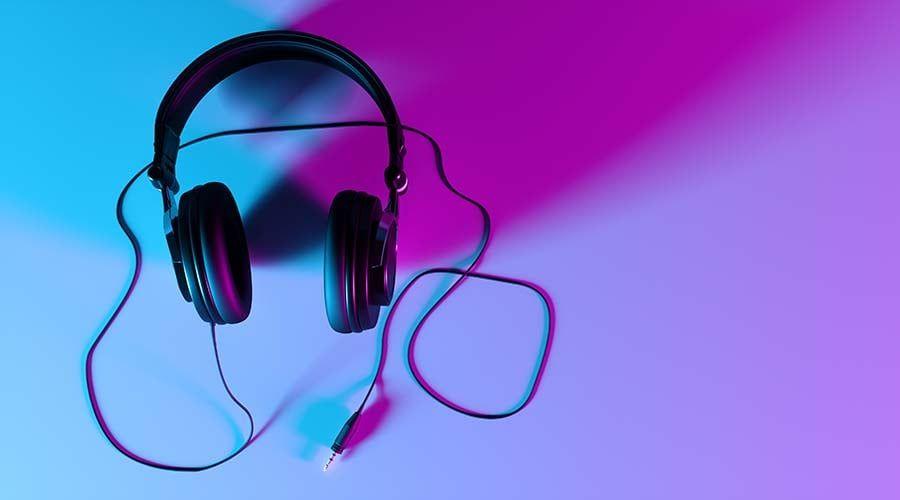 headphones on a black background close-up in neon light, 3d illustration
